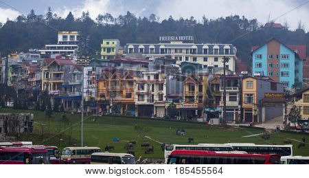 Sa Pa, Vietnam - March 12, 2017: Colorful houses in the city center of small mountain town of Sa Pa, Vietnam