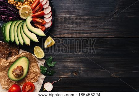 Healthy Vegan Food Concept. Healthy Food With Vegetables And Whole Wheat Bread On The Wooden Table T