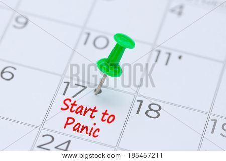 start to panic written on a calendar with a green push pin to remind you and important appointment.