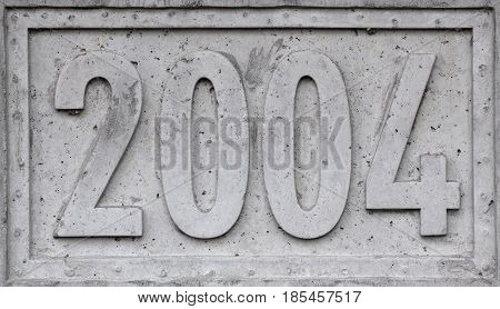 Concrete Block With The Year 2004 Engraved