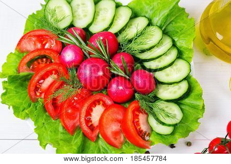 Coarsely Chopped Fresh Cucumber, Tomato, Radish And Lettuce - Fresh Salad. The Concept Of Healthy Ea