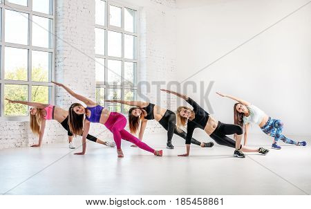 Young women carry out training in dance class. The concept of sport dance and a healthy lifestyle.