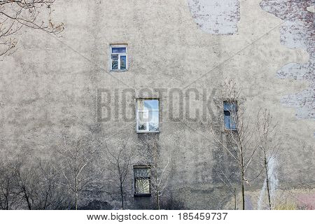 The wall of the house with unordered windows