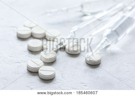 doctor's instruments and pills in medical set on white dest background
