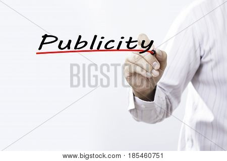 Businessman hand writing publicity with red marker on transparent wipe board business concept