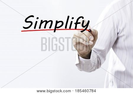 Businessman hand writing simplify with red marker on transparent wipe board business concept