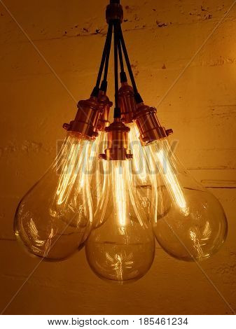 Bunch of light bulbs on concrete background. Modern design with retro feel.