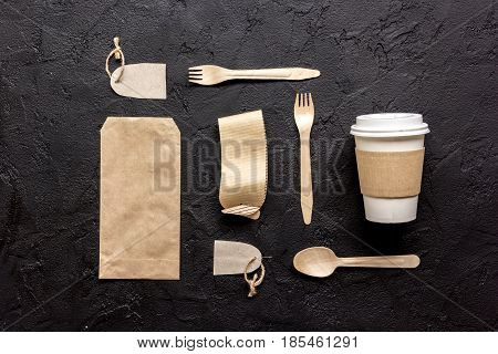 paper bags for food delivery on restourant dark table background top view mockup