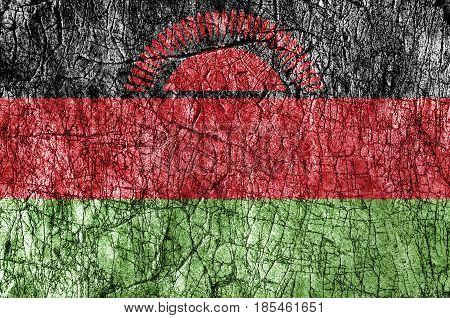Grudge stone painted Malawi flag close up