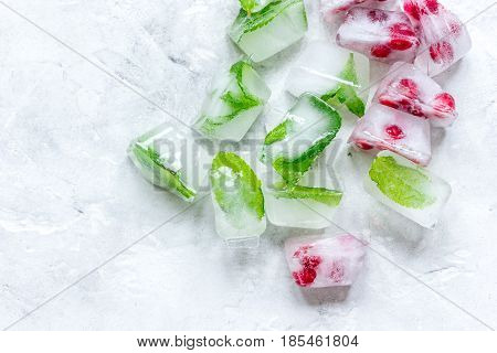 fresh cranberry frozen in ice cubes on gray stone desk background top view mock-up