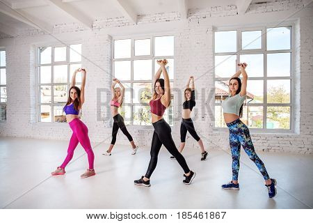 Group of people dancing in the gym. Training. The concept of sport dance and a healthy lifestyle.