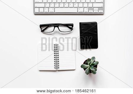 Workspace with keyboard and wallet on office desk white background top view mock up