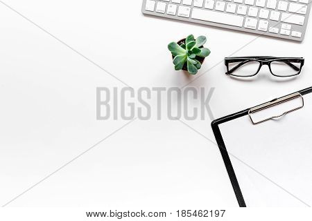 modern flat lay with office items for work on white desk background top view mockup