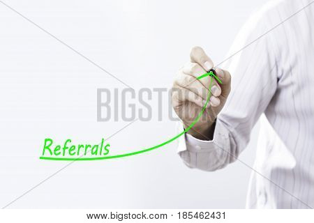 Businessman draw growing line symbolize growing referrals.