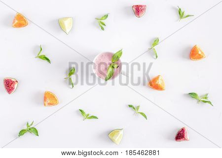 mint, cut citrus, organic yoghurt design on white wooden desk background top view pattern