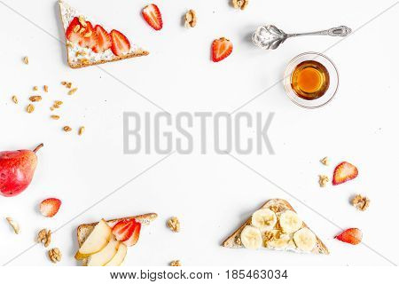 healthy breakfast with sandwiches set on white table background top view mockup