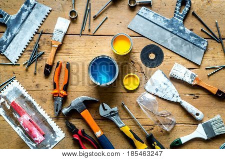 professional builder work desk with house renovation instruments on wooden background top view