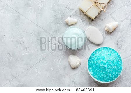 blue organic set for bath with salt and shells on stone table background top view mock up