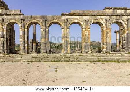 Exterior of the Basilica at archaeological Site of Volubilis ancient Roman empire city Unesco World Heritage Site located in Morocco near Meknes poster