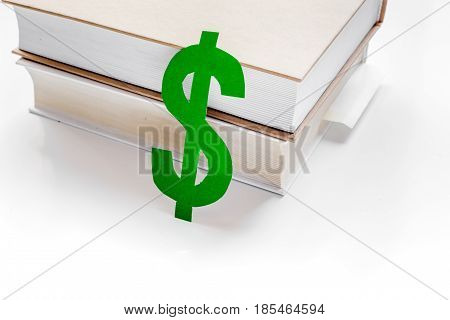 fee-paying education set with dollar sign on white table background top view