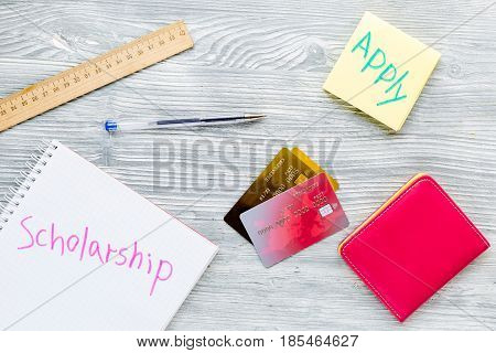 scolarship apply with credit cards and wallet on white table background top view