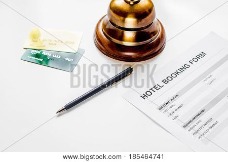 hotel reception desk with booking form on white background