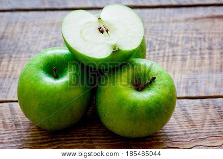 Healthy green food with apples on kitchen wooden desk background