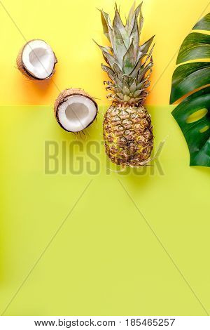 tropical fruits for summer design on yellow table background top view mock-up