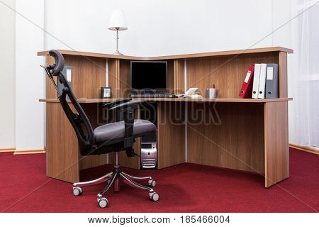 office desk with a computer in the room