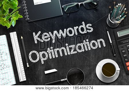 Black Chalkboard with Handwritten Business Concept - Keywords Optimization - on Black Office Desk and Other Office Supplies Around. Top View. 3d Rendering. Toned Image.
