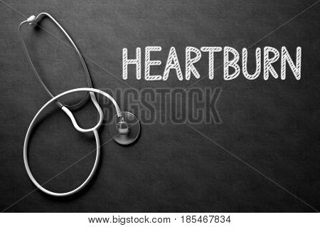 Medical Concept: Heartburn Handwritten on Black Chalkboard. Top View of White Stethoscope on Chalkboard. 3D Rendering.