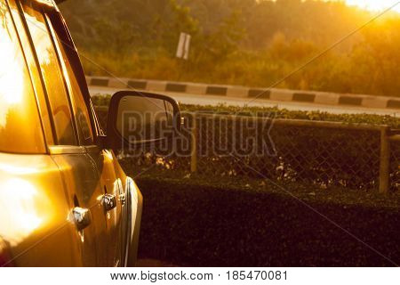 Car at parking area on morning time with sunlight.