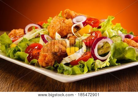 Fried chicken nuggets with vegetable salad