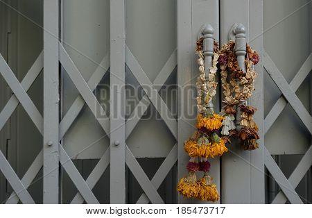 Dried garland hanging on the door handle.