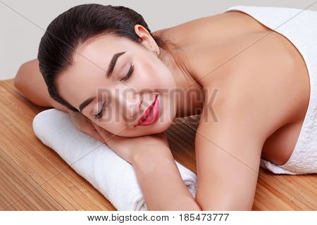 Young beautiful woman relaxing at spa salon