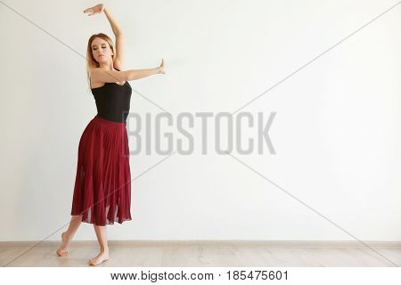 Beautiful young woman in dance studio