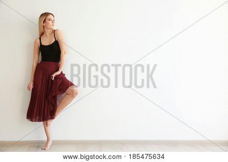 Beautiful young woman in dance studio