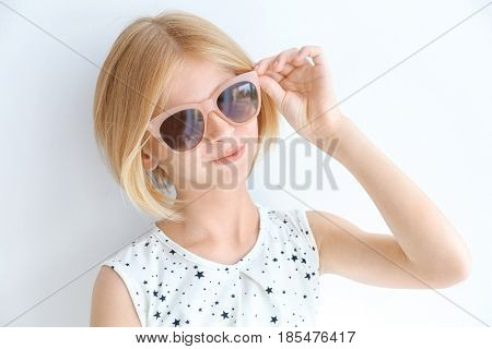 Portrait of attractive teenager girl  in sunglasses on white background