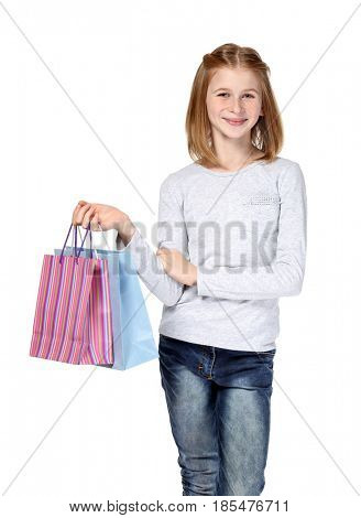 Cute girl with paper bags on white background