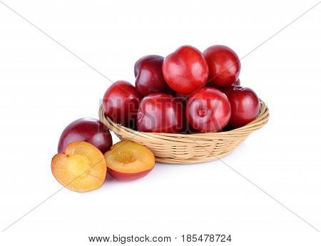 fresh gulf ruby plum in the basket and on white background