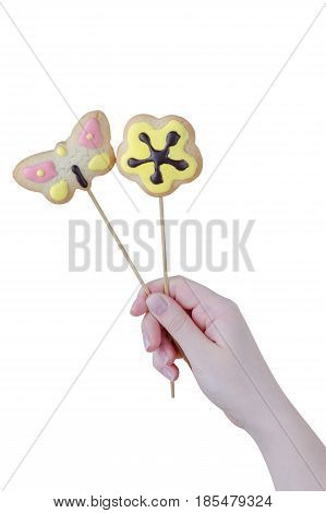 Woman's Hands Holding A Valentine Cookies Isolated On White Background