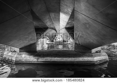 Underneath a large bridge made from concrete