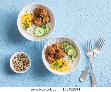 Fish chips rice and mango on a blue background top view. Delicious appetizer tapas