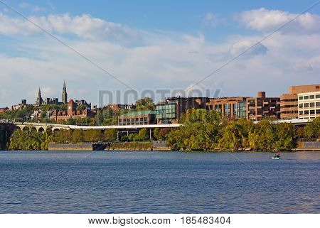 Kayaking on Potomac River along Georgetown Park waterfront. Early autumn in Georgetown neighborhood of Washington DC USA.