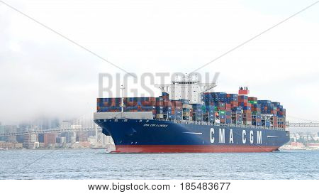Oakland CA - May 05 2017: CMA CGM A. LINCOLN in route to the Port of Oakland through the San Francisco Bay. Compagnie Generale Maritime is the third largest shipping company in the world.