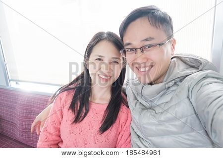 couple selfie and smile happily in the bus