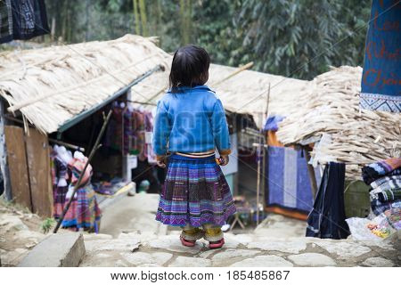 Sa Pa, Vietnam - 12 March, 2017:  Unidentified ethnic Hmong minority kid in the rural area of Sa Pa, Northern Vietnam, near the border with China