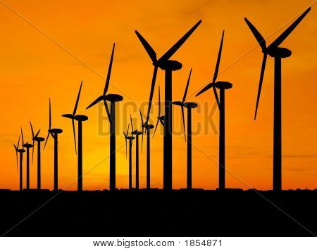 Wind Generators Over Orange Sky