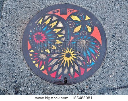 Nagano, Japan - February 20, 2017: A manhole cover of Matsumoto city, Nagano Prefecture, Japan. Temari balls engraved on a manhole cover. Matsumoto-temari are folkcraft balls decorated with yarn.