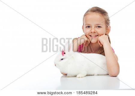 Happy young girl and her grumpy white bunny - isolated